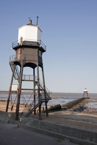 Victorian cast iron lighthouses on beach, Dovercourt, Harwich, Essex, England, July