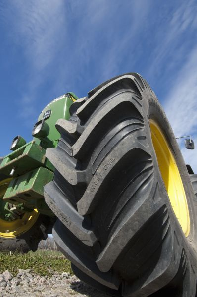 90255-00379-755. John Deere 4455 tractor, close-up of wheel, Sweden, may