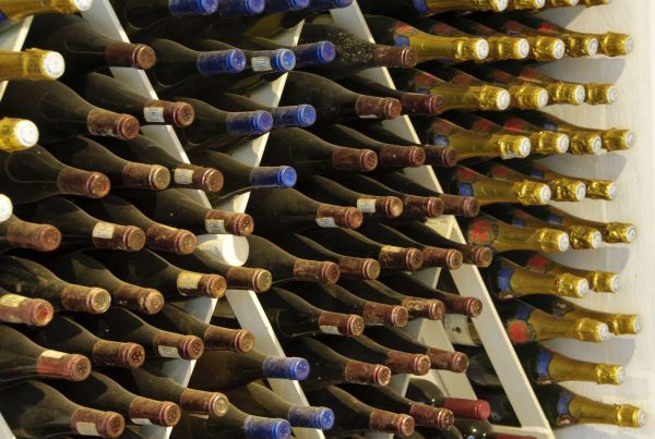 90351-00142-821. Close-up of wine bottles stored in cellar